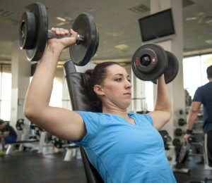 woman doing weight lifting exercises