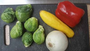 picture of brussel sprouts, onion, red bell pepper, squash