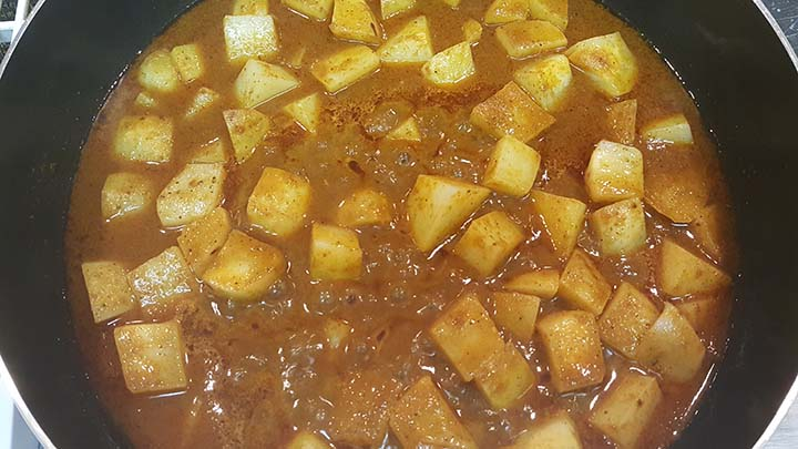 potatoes simmering in curry paste